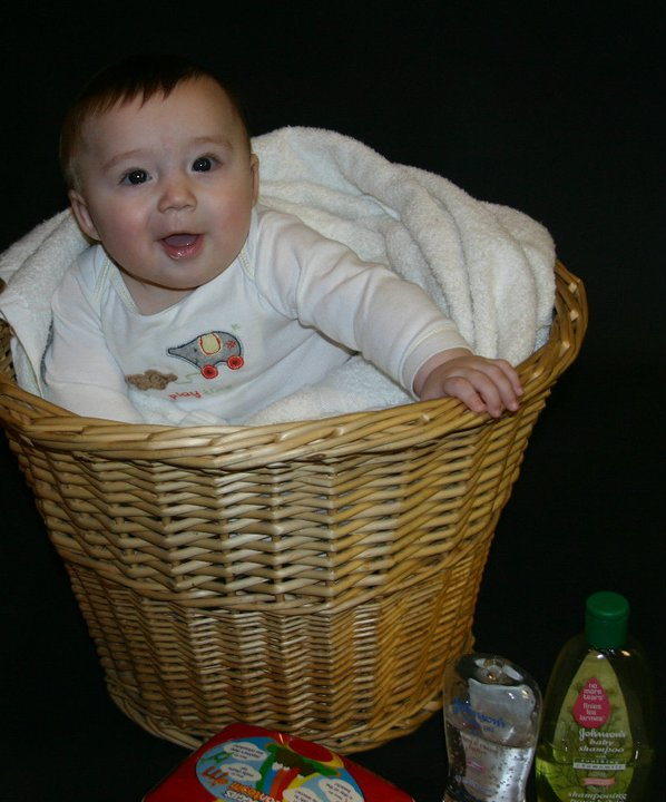 baby Christian inside a basket